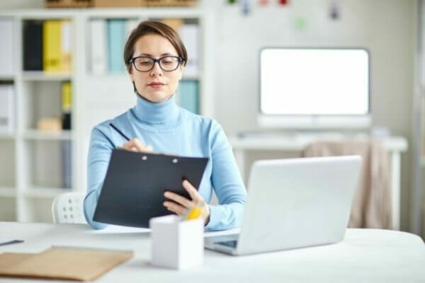 woman using a laptop to make test rules
