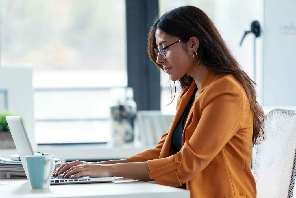 business woman completing proctored certification test